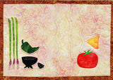 Mexican Food Place Mat pictures a quilted placemat with chives, mocajete, jalapeño, tomato and corn chip.  Design by Wendy Christine at Raspberry Lane Crafts.  Part of the Dinner-On-Us Placemats pattern.