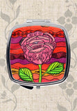 Buy Beautiful Purse Compact Mirrors.  This one is called Mission Rose from The Art of Wendy Christine and features a Southwest pink rose on red, plum and orange.