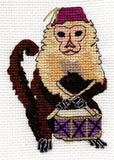 Buy Monkey Drummer cross stitch features a capuchin monkey with purple drum and fez.  Available to buy at Raspberry Lane Crafts.