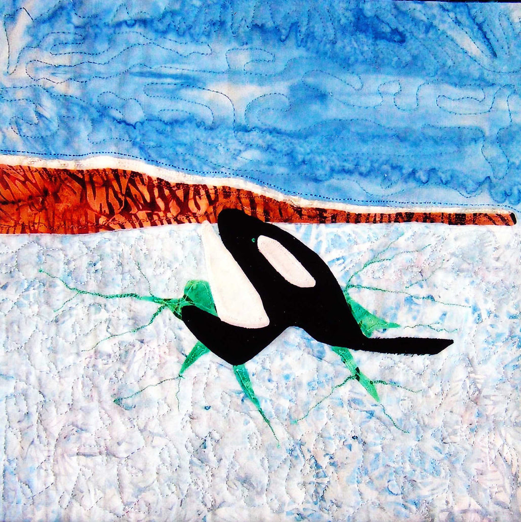 """Orca Through Ice"" quilt block features an orca's head poking through broken ice sheet with a rocky shore and blue skies. Raspberry Lane Crafts. Quilt Block pattern. Ice Habitats Collection. Wendy Christine"