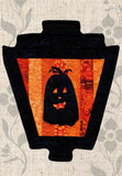 Buy Black pumpkin silhouette on orange stripes gaslight lantern Halloween quilt pattern decoration sold at Raspberry Lane Crafts.