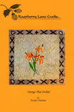 Orange Thai Orchid quilt block pattern front cover is orange with a photo of the orange orchid with a decorated border of X's by Wendy Christine at Raspberry Lane Crafts