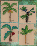 Palm tree cross stitch pattern finished photo features a date palm, chusan palm, coconut tree, and banana tree.  Raspberry Lane Crafts.