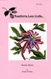 Passion Flower cross stitch pattern front cover is pink with color picture of finished cross-stitch.