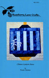 Chinese Lantern quilt block pattern cover page features a blue page with Raspberry Lane Crafts logo and a photo of the finished blue lantern with Chinese symbol for peace. Designed by Wendy Christine at www.raspberrylanecrafts.com