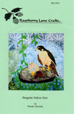 Peregrine Falcon Nest Quilt Block Pattern front cover features a falcon and her chick in a vine strewn nest. #6 in the Mountain Habitats Series by Wendy Christine