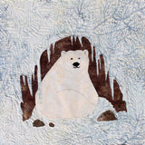 Raspberry Lane Crafts Polar Bear Cave features a sitting polar bear in an icicle entrance cave with rocks.  Designed by Wendy Christine