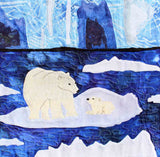 """Polar Bear with Cub"" quilt block shows two polar bears floating on an iceberg in indigo blue water, an ice wall with caves background. Ice Habitats Collection. Raspberry Lane Crafts. Wendy Christine"