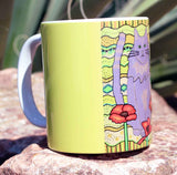 Poppy Cat Mug features a gray fluffy cat on yellow.  For sale at Raspberry Lane Crafts.  The Art of Wendy Christine.
