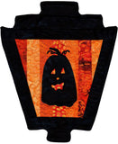 Black pumpkin silhouette on orange stripes gaslight lantern Halloween quilt pattern decoration sold at Raspberry Lane Crafts.