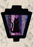 Buy Black cat silhouette on purple strips gaslight lantern sewing quilt pattern for Halloween buy at Raspberry Lane Crafts.