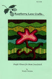 Front cover page of Purple Flower for Mom CrossStitch features a color photo of the stitched design on a green paper background at Raspberry Lane Crafts.