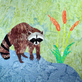 Raccoon by the Stream quilt block pattern features a raccoon by the water and cattails.  Designed by Wendy Christine at Raspberry Lane Crafts