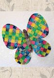 Rainbow Butterfly quilt pattern design is made of diamond squares sewn together with a raw edge.  For sale at Raspberry Lane Crafts.