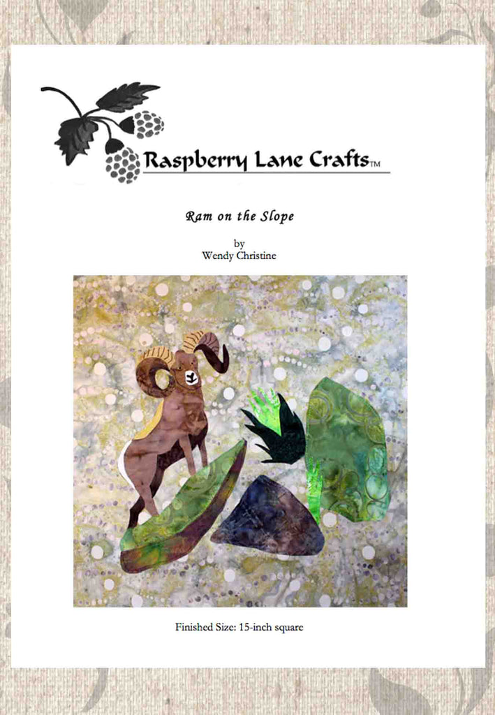 Buy Ram on the Slope quilt block pattern digital download features the finished block of a brown gray bighorn sheep on a slanted rocky slope with green grasses. Available at Raspberry Lane Crafts.
