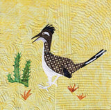 "Raspberry Lane Crafts ""The Roadrunner"" Quilt Block pattern features a road runner with green cactus and rusty grass.  Part of the Desert Habitats Quilt Collection"