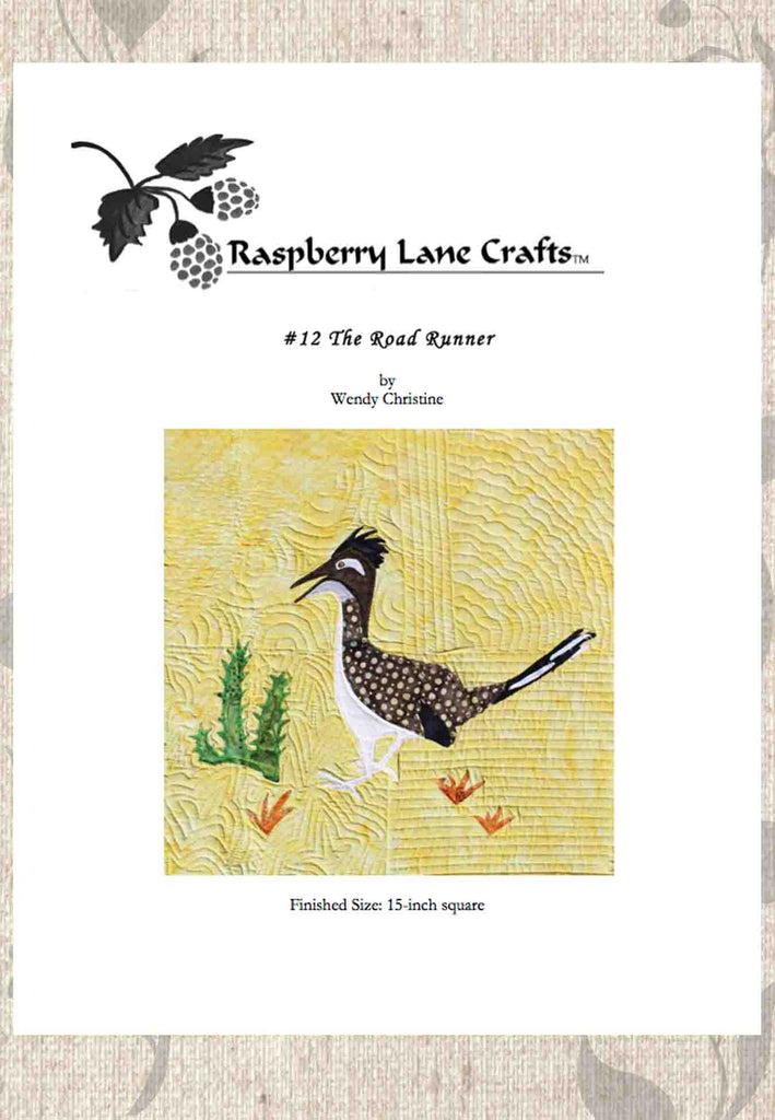 The Road Runner quilt block pattern digital download front page includes Raspberry Lane Crafts logo and picture of completed block a road runner with cactus and rusty grass.  Purchase at Raspberry Lane Crafts.