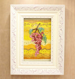 Buy grapes cross-stitch pattern download.  White grape decorated frame hold Rosanella Grapes in pink, red and green on a golden wavy background cross stitch.  Pattern available at Raspberry Lane Crafts.  by Wendy Christine