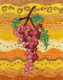 Rosanella Grapes Cross Stitch pattern features red pink grapes, bright green leaves on a decorated yellow backdrop.  Adapted from The Art of Wendy Christine.  Available at Raspberry Lane Crafts.