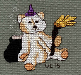Scary Bear Witch features a tan teddy bear wearing a purple witch hat, holding a straw broom with a bubbling cauldron.