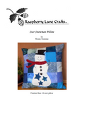 Star Snowman flannel checkerboard blue pillow pattern digital download front page features a white snowman with black topcoat, red scarf, black buttons and three navy stars on a background of blue flannel squares.  Buy at Raspberry Lane Crafts.