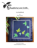 Ivy Leaves Needlebook cross stitch pattern features a vine of seven green and teal leaves on a navy background with petite square border.  Purchase at Raspberry Lane Crafts.