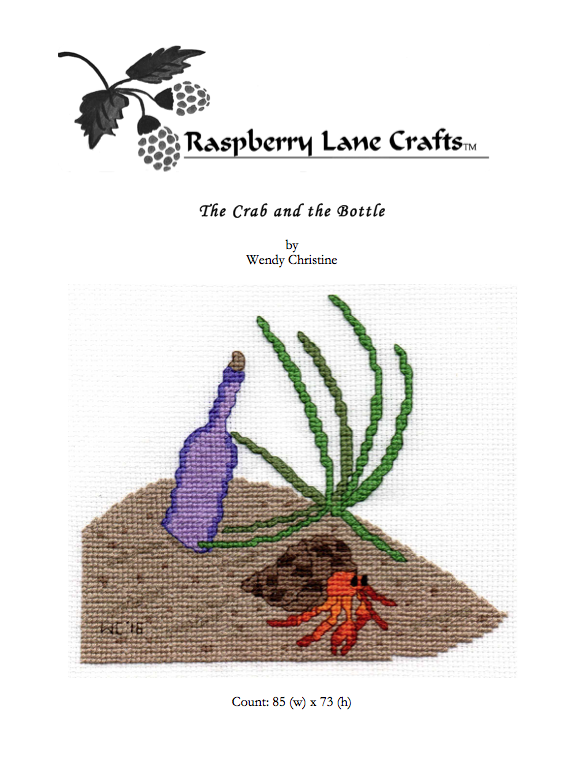 The Crab and the Bottle cross stitch pattern digital download features a hermit crab on the beach with green beach grass and a purple bottle.