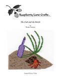 Purchase Find The Crab and the Bottle cross stitch pattern digital download features a hermit crab on the beach with green beach grass and a purple bottle.