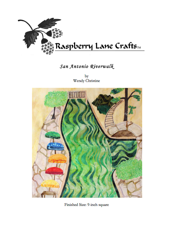 San Antonio Riverwalk quilt block pattern digital download features a green river lined with tan flagstone, arched walkways, stairs, bridges, trees and rainbow of umbrellas.  Purchase at Raspberry Lane Crafts.
