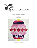 Chinese Lantern Freedom quilt block pattern digital download features the completed pattern in red purples and mauves of the pieced pattern with Raspberry Lane Crafts logo.  Purchase buy at www.raspberrylanecrafts.com