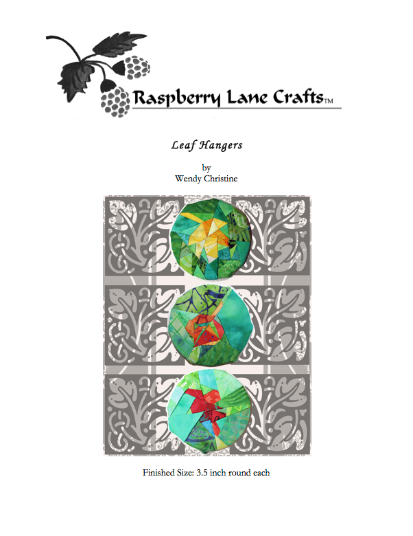Leaf Hangers sewing pattern digital download front page features the Raspberry Lane Crafts logo and completed leaf hangers: a red oak on green, an orange aspen leaf on green, and a yellow maple leaf on green.  Pattern available at Raspberry Lane Crafts.