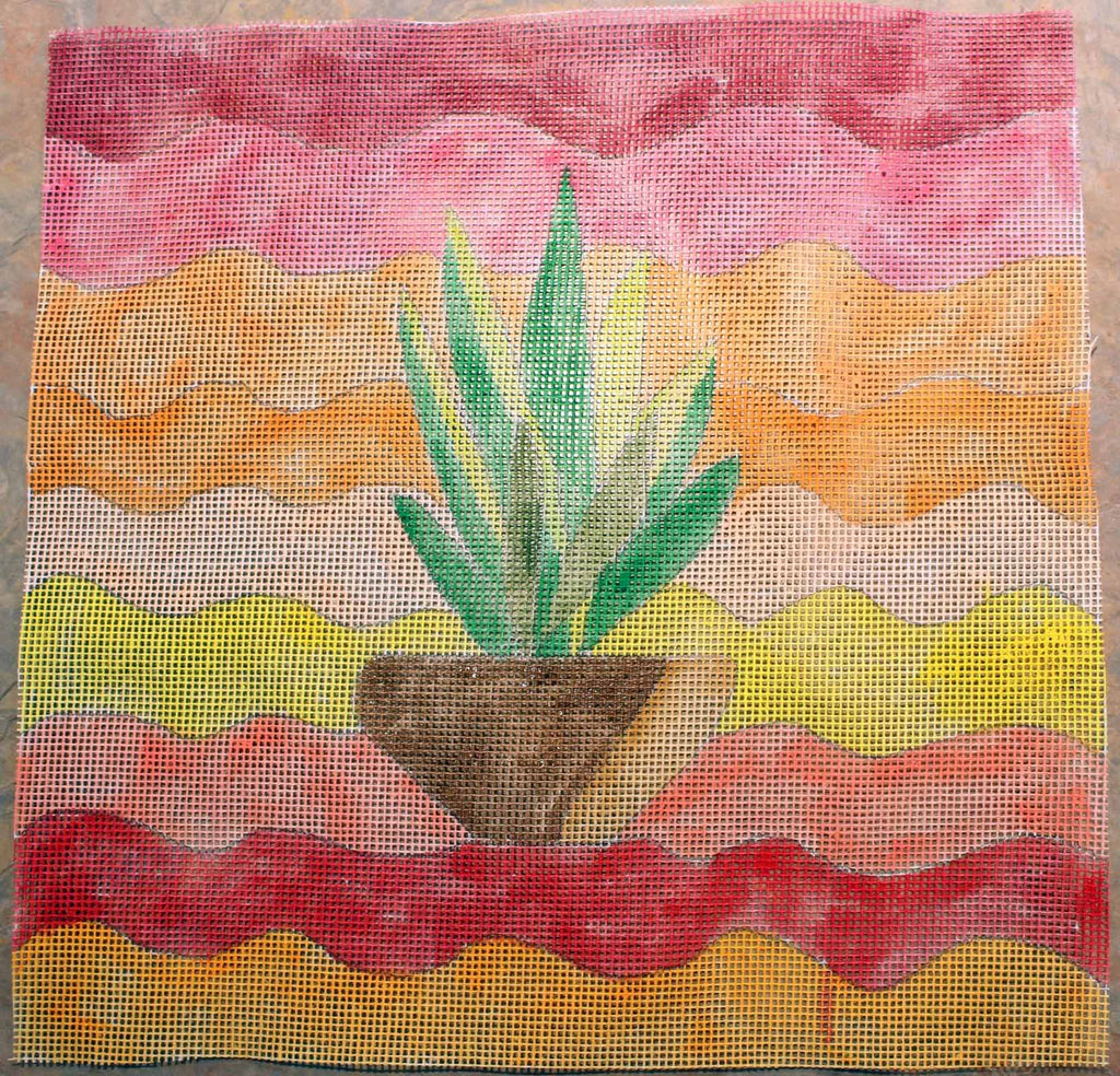 Southwest Yucca needlepoint canvas handpainted green yucca in brown pot with waves of orange, yellow, red and peach from Wendy Christine at Raspberry Lane Crafts
