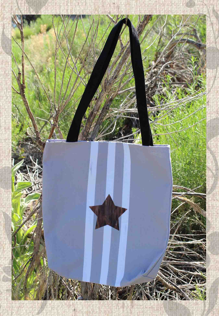 Taupe Star Tote Bags for Sale feature a brown star with three white stripes.  The Art of Wendy Christine.