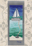 Tropical Sailing Bookmark Cross Stitch Pattern features a sailboat with anchor on sand with blue and turquoise.  For sale at Raspberry Lane Crafts.