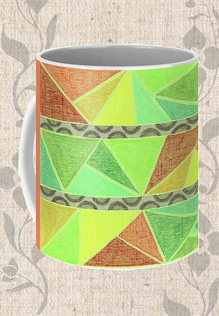 Tunisia Coffee Mug features red orange yellow green triangles and snow leopard spots with coral wrap-around.  Find Buy Purchase at Raspberry Lane Crafts