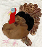 Close up of the brown, red and black turkey featured in the Turkey and Apples Tablerunner.
