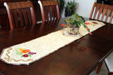 Completed Turkey and Apples Tablerunner on a dining room table with a Christmas Cactus blooming.