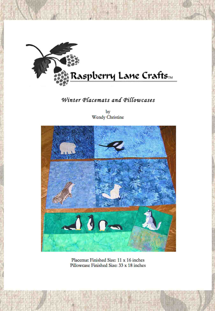 Winter placemats and pillowcases digital download pattern for sale at Raspberry Lane Crafts includes four placemats with polar bear, orca, arctic fox and seal in fusible interfacing.  Pillowcases include penguins and husky.  Quilted Pattern.