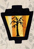 Dead tree silhouette on yellow stripes gaslight lantern Halloween sewing quilt pattern for purchase at Raspberry Lane Crafts.