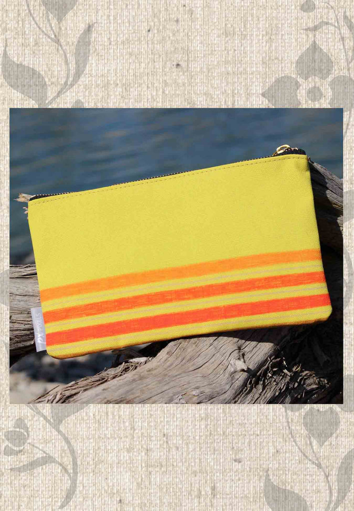 Yellow Stripe Accessory Pouches feature a zipper shave bag or cosmetics bag yellow with orange red and brown stripes.  Find Purchase Buy at Raspberry Lane Crafts