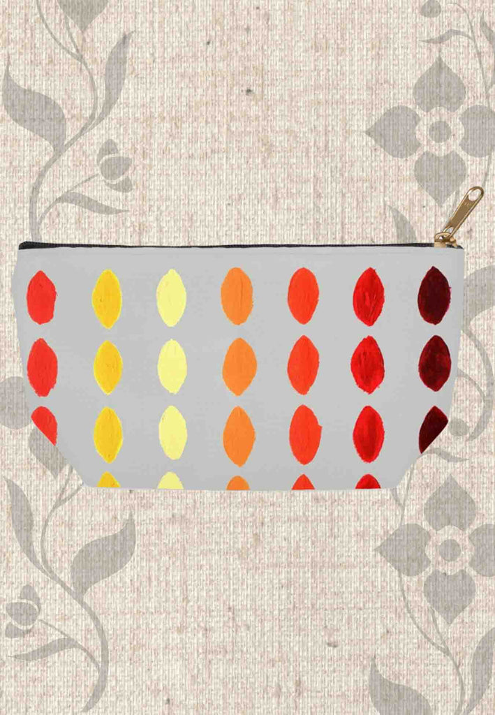 Yucatan Fuego Accessory Pouches Zipper Bags for Sale feature red yellow and orange geometric shapes on gray.  For Sale at Raspberry Lane Crafts