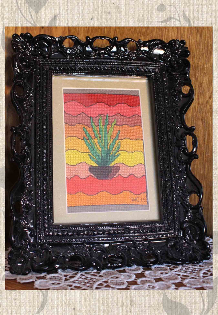 Buy Southwest Cactus Cross Stitch with Orange Red Yellow and Green.  For Sale at Raspberry Lane Crafts.  Shown framed.