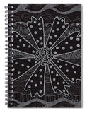 Charcoal Daisy spiral notebook journal features a black and white flower with dots and decorated with stripes, triangles and leaves.  The Art of Wendy Christine.  Buy at Raspberry Lane Crafts.