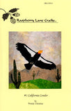 """California Condor"" quilt block features a black and white condor with orange head swooping over hills of saguaro cactus with a mountainous background."