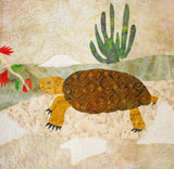 Raspberry Lane Crafts Desert Tortoise Quilt Block Pattern features a geometric pattern shell with tan faced tortoise on a rocky desert floor with a senita cactus.  Part of the Desert Habitats Quilt Collection by Wendy Christine