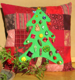 Holiday Pine Pillow pattern features a bright green decorated tree on a pieced flannel squares background by Wendy Christine at Raspberry Lane Crafts.