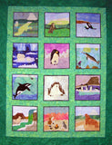 The Ice Habitats Collection finished quilt is featured here with twelve arctic and antarctic animals with scenery.  Purchase at Raspberry Lane Crafts.