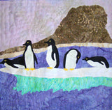 """Penguins on Ice"" quilt block features five penguins on a jutting ice floe with a rocky shore. Raspberry Lane Crafts. Ice Habitats Collection by Wendy Christine."
