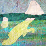 """Polar Bear Swimming"" quilt block shows a mostly submerged polar bear ocean-swimming near icebergs. Ice Habitats Quilt Collection. Raspberry Lane Crafts. Wendy Christine"