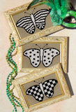 Mardi Gras Butterfly Collection cross stitch pattern picture of three butterflies on harlequin backdrop: a spotted, striped and checkered butterfly in black and white by Wendy Christine at Raspberry Lane Crafts. Buy Purchase Find